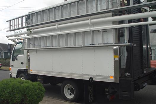 Secure ladders safely on solid, substantial custom racks.