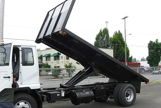 Summit flatbeds with optional self-dumping hoists make easy work of unloading.